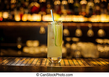Glass of a Lynchburg lemonade cocktail on the wooden steel bar counter