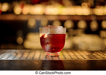 Glass of a Vieux Carre cocktail on the steel wooden bar counter