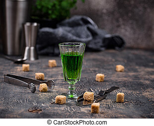 Glass of absinthe with cane sugar - Glass of absinthe drink ...
