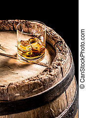 Glass of aged Scotch in the distillery basement