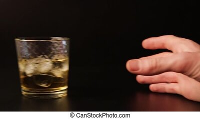 Glass of alcohol sliding across the bar counter, slow...