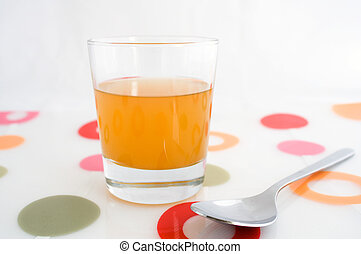 Glass of apple cider vinegar - A glass of raw, unfiltered...