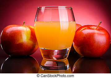 Glass of apple juice with apples