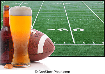 Glass of Beer and American Football - A frothy glass of beer...