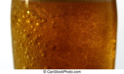 Glass of beer bubbling on white bac