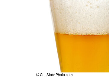 Glass of beer closeup with froth