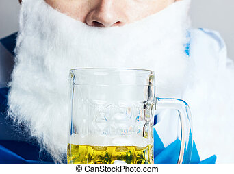 glass of beer in front of face of man with bavarian flag
