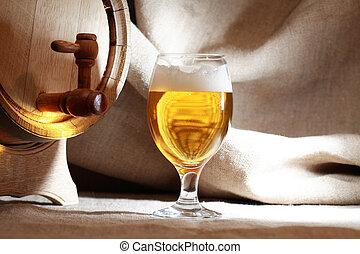 Glass Of Beer Near Barrel