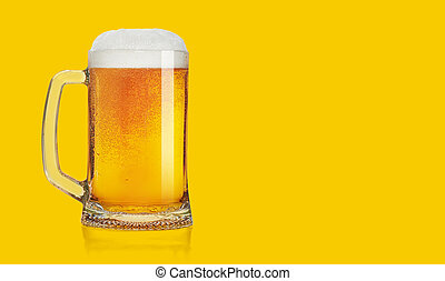 Glass of beer on a yellow background background