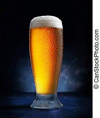 glass of beer on dark blue background