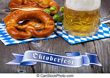 Glass of beer, pretzels and Oktoberfest Banners - A beer mug...