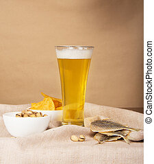 Glass of beer, salty fish and fried potatoes