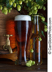 Glass of beer with barrel
