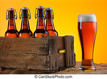 beer with bottles in crate - Glass of beer with bottles in ...