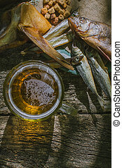 glass of beer with dried fish