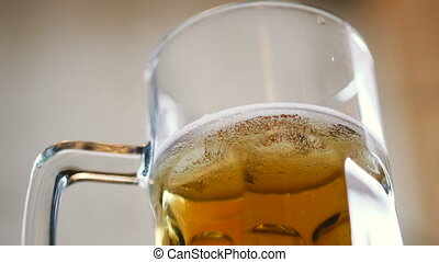 Glass of beer with frothy beer