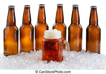 Glass of beer with six pack of ice cold bottles isolated on ...