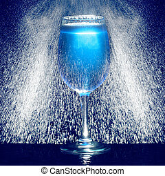 Glass of blue fresh liquid drink