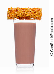 Glass of breakfast chocolate milk with cereal bar