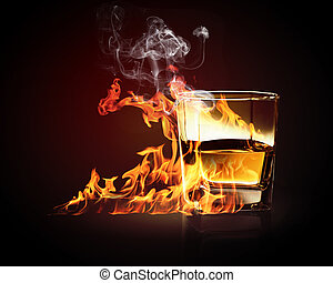 Glass of burning yellow absinthe - Image of glass of burning...