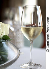 glass of champage on the table with flower