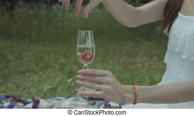 Glass of champagne with tasty red strawberry