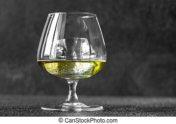 Glass of Chartreuse on the rocks