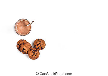 Glass of chocolate milk with oat cookies on white background. Top view