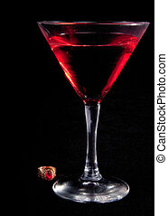 glass of cocktails and jewelry on a black background