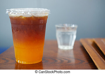 Glass of coffee with orange soda