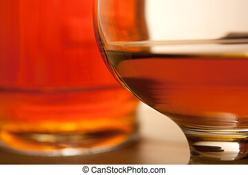 cognac - glass of cognac and bottle. Close-up