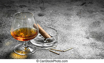 glass of cognac with a cigar.