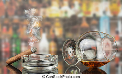 Glass of cognac with cigar