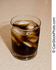Glass of Cola - A glass of cola with ice on a granite...