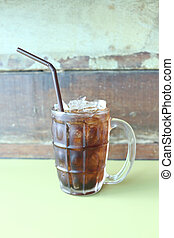 Glass of cola on a table in a restaurant.