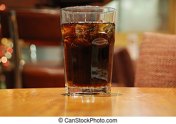 Glass of cola - A glass of cola with ice cubes, on a...