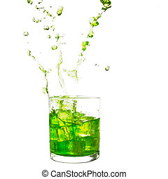 Glass of cold lime green drink with water splash and ice cubes.