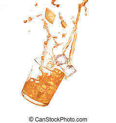 Glass of cold orange drink with water splash and ice cubes....