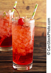 Glass of Cold Refreshing Cherry Limeade on a Wooden Table