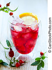 cold rose hip tea - glass of cold rose hip tea