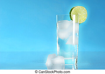 Glass of cold water with ice cubes