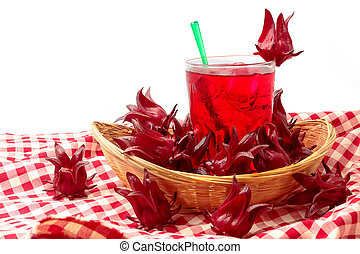Glass of delicious roselle juice with fresh roselle on white background