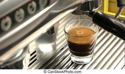 Glass of espresso with foam.