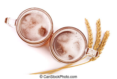glass of foamy beer with wheat isolated on white background. Top view