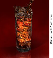 glass of fresh drink on black background