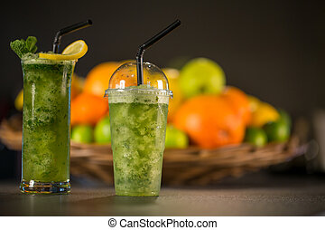 Glass of fresh green smoothie made from mint, apple and spinach