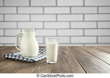 Wooden tabletop with wheat on blur kitchen room background for montage product. Copy space.