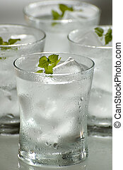 water - glass of fresh water with ice close up