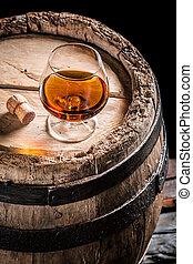 Glass of good cognac in the distillery basement