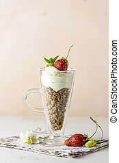 Glass of healthy breakfast with granola and greek yogurt ...